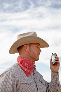 cowboy with cell phone