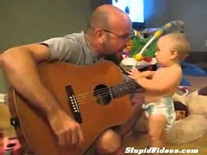 Man playing guitar for baby