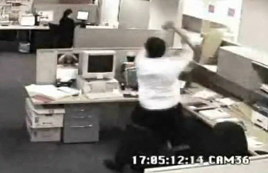 Man smashing his computer with Bad Day At Work Pictures