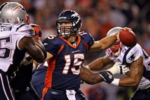 Tim Tebow throwing a pass