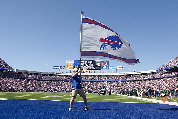 man waving a Bills flag at Ralph Wilson Stadium
