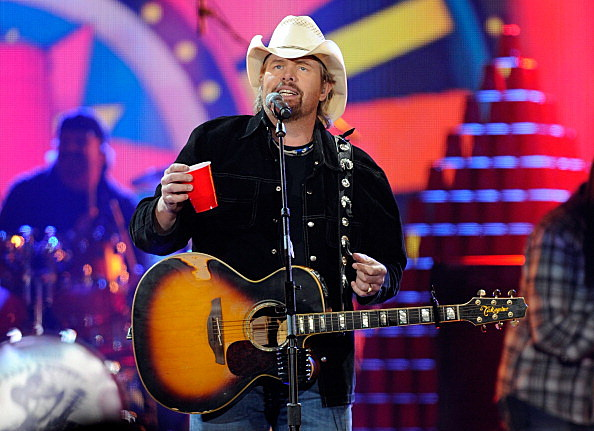 Toby Keith holding a red solo cup