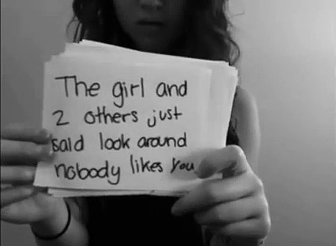 "Amanda Todd holding up a paper that says ""Nobody Likes You"""