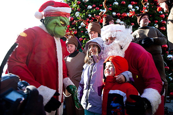 Grinch and Santa (Getty Images)