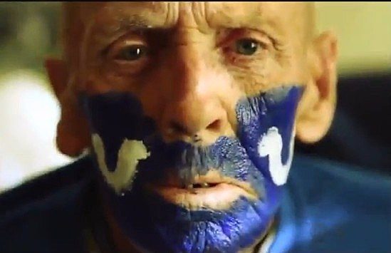 Old man with his face painted