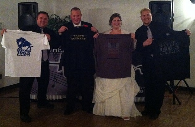 Wedding couple holding up Taste of Country T-shirts