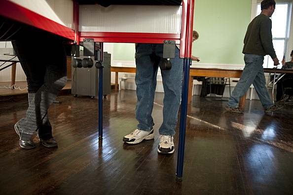 person standing at a voting machine