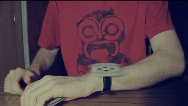 Man spinning a card on his watch