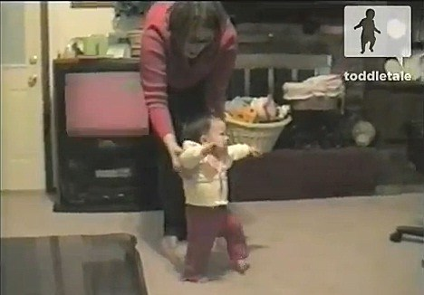 a baby taking her first steps
