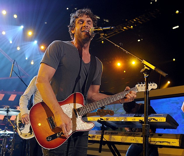 Billy Currington playing guitar