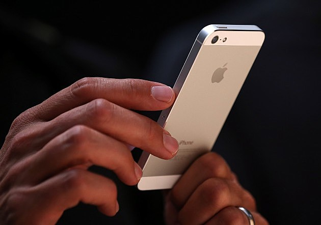 Hands holding an iPhone