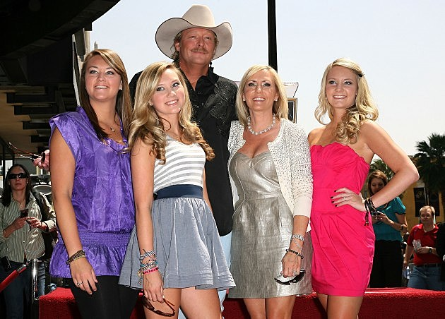 Alan Jackson with his wife and daughters