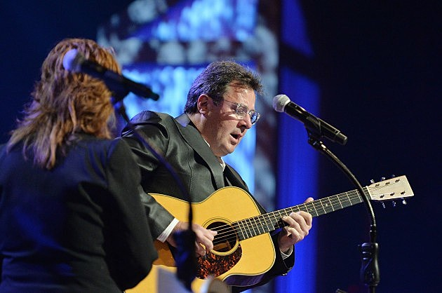 Vince Gill playing guitar