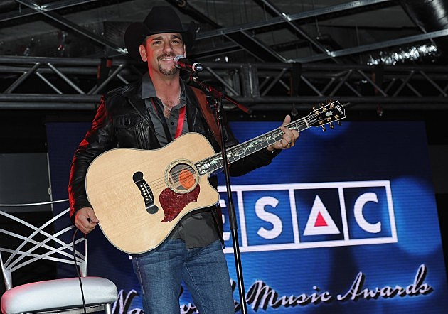 Craig Campbell holding a guitar on stage