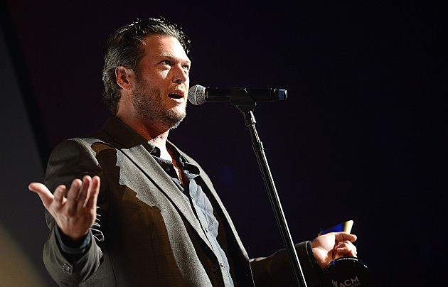 Blake Shelton talking into a microphone