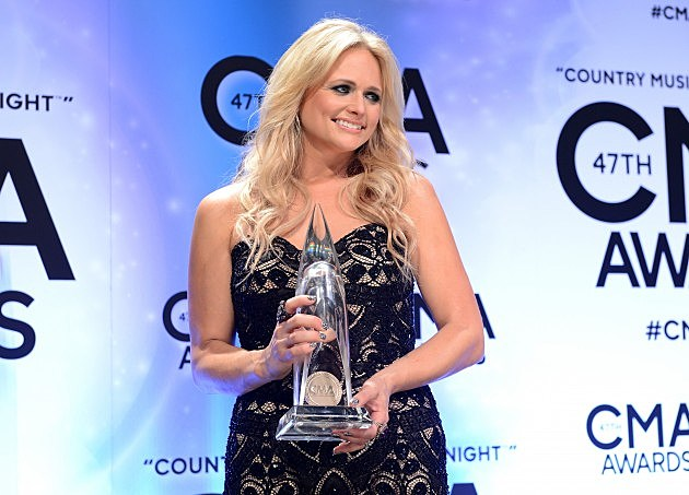 Miranda Lambert holding her CMA Award
