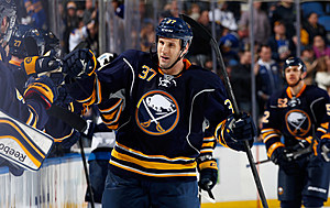 Matt Ellis is congratulated after scoring Buffalo's fourth goal (Getty Images)