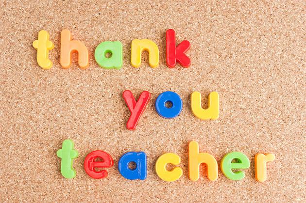 Thank you teacher message on cork board.
